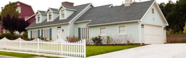 Blue Exterior - White Picket Fence - Green Grass